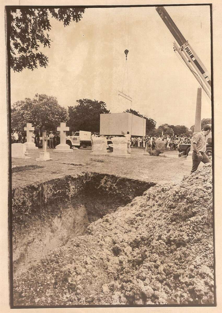 And while many gathered for the burial, none were mourning family or friends. Instead, around 300 spectators and reporters looked on to witness a crane navigate around tombstones and place the box into a grave measuring 19 feet long, 10 feet wide and 9 feet deep, according to an original Express-News report from May 19, 1977.