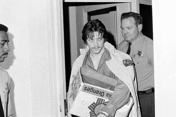 Robert Beausoleil, center, leaves a Los Angeles Superior courtroom after his plea for a new trial on charges of murdering musician Gary Hinman was rejected, June 15, 1970, Los Angeles, Calif. Judge William Keene then sentenced Beausoleil, onetime member of Charles Mansion family, to death in San Quentin's gas chamber.