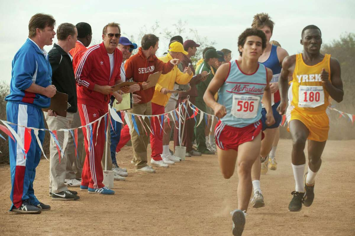 """Kevin Costner (third from left) and Hector Duran (foreground right) in """"McFarland, USA."""""""