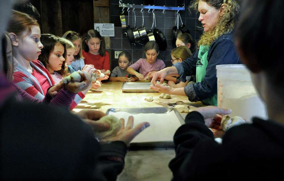 Under the guidence of teacher students learn to shape dough to make snowball rolls during a cooking class for kids at The Silo at Hunt's Hill Farm in New Milford, Conn., Monday, February 16, 2015. Photo: Carol Kaliff / The News-Times
