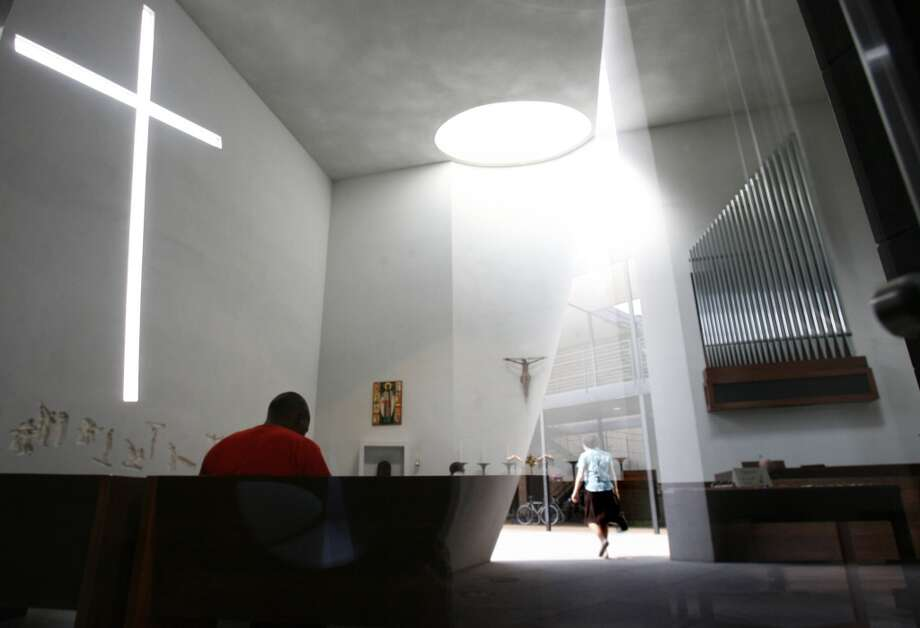 Inside the Chapel of St. Basil, sunlight puts on a show: The tilted-cross window plays against dramatic skylights. Photo: Sharon Steinmann, Houston Chronicle