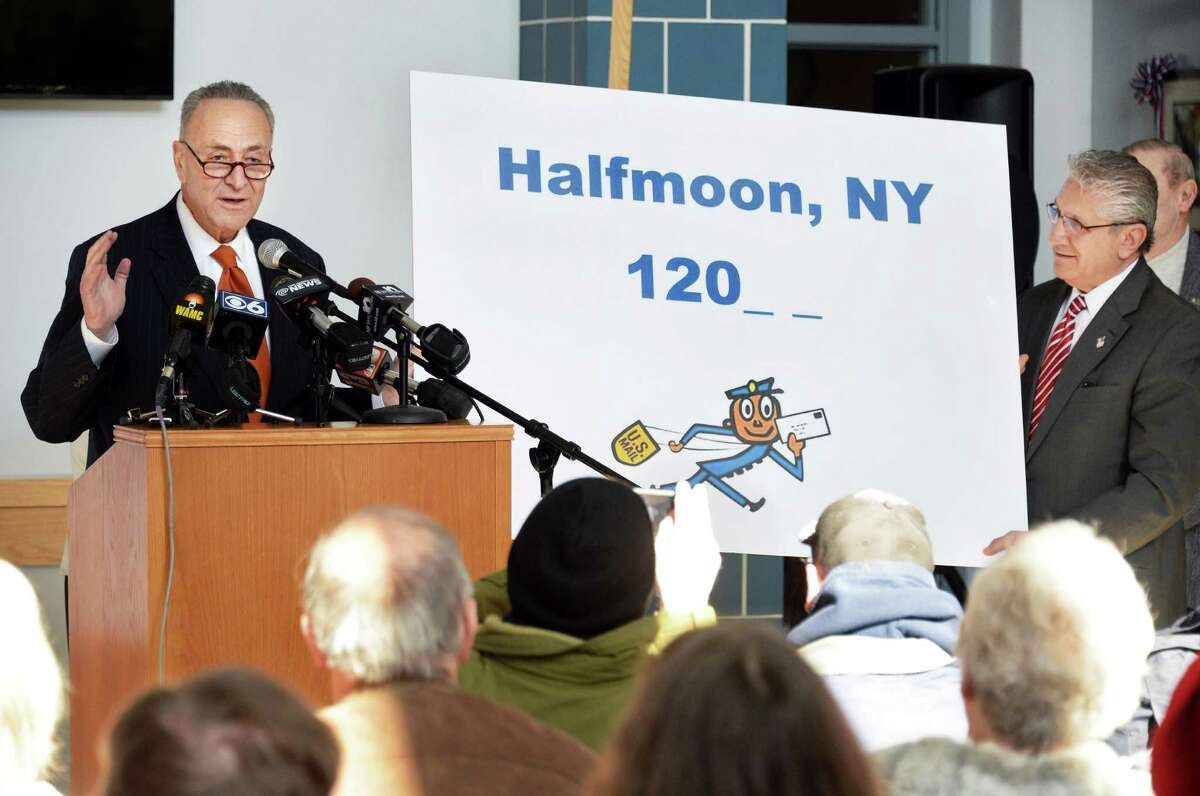 U.S. Senator Charles Schumer, left, and Assemblyman James Tedisco hold a poster as the push to secure a zip code for Halfmoon is announced at Halfmoon Town Hall Wednesday, Feb. 18, 2015, in Halfmoon, NY. The Town of Halfmoon is currently is split among four different towns' zip codes. (John Carl D'Annibale / Times Union)