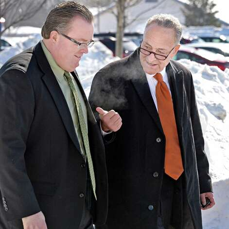 U.S. Senator Charles Schumer, right, speaks with Town Supervisor Kevin Tollisen as the Senator arrives to announce the push to secure a zip code for Halfmoon is announced at Halfmoon Town Hall Wednesday, Feb. 18, 2015, in Halfmoon, NY. The Town of Halfmoon is currently is split among four different towns' zip codes. (John Carl D'Annibale / Times Union) Photo: John Carl D'Annibale / 00030669A