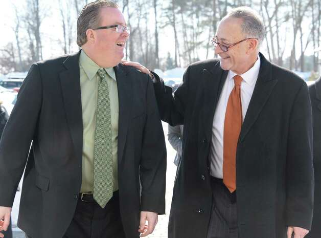 U.S. Senator Charles Schumer, right, is greeted by Town Supervisor Kevin Tollisen as he arrives to announce the push to secure  zip code for Halfmoon is announced at Halfmoon Town Hall Wednesday, Feb. 18, 2015, in Halfmoon, NY. The Town of Halfmoon is currently is split among four different towns' zip codes. (John Carl D'Annibale / Times Union) Photo: John Carl D'Annibale / 00030669A