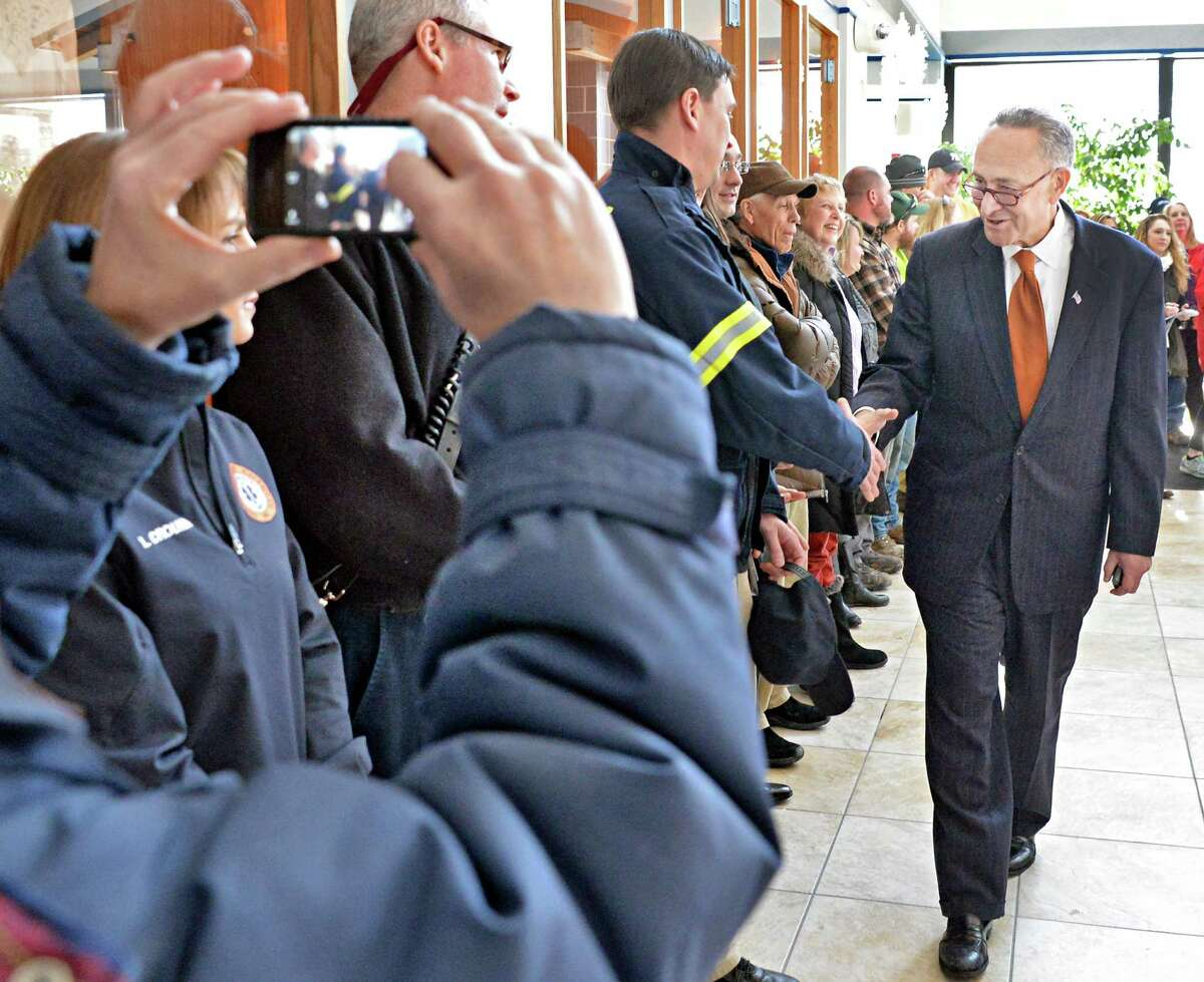 U.S. Senator Charles Schumer, greets town residents as he arrives to announce the push to secure a zip code for Halfmoon is announced at Halfmoon Town Hall Wednesday, Feb. 18, 2015, in Halfmoon, NY. The Town of Halfmoon is currently is split among four different towns' zip codes. (John Carl D'Annibale / Times Union)