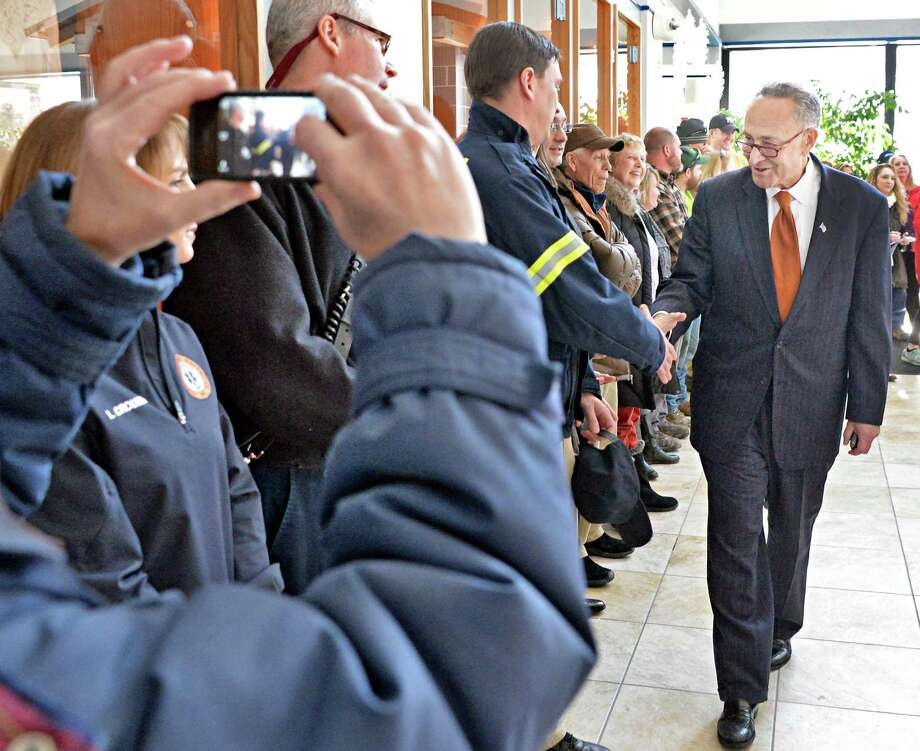 U.S. Senator Charles Schumer, greets town residents as he arrives to announce the push to secure a  zip code for Halfmoon is announced at Halfmoon Town Hall Wednesday, Feb. 18, 2015, in Halfmoon, NY. The Town of Halfmoon is currently is split among four different towns' zip codes. (John Carl D'Annibale / Times Union) Photo: John Carl D'Annibale / 00030669A