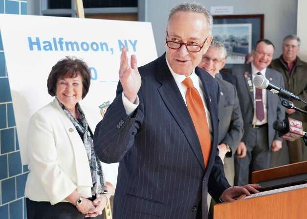 U.S. Senator Charles Schumer, center, announces his efforts to secure a  zip code for Halfmoon is announced at Halfmoon Town Hall Wednesday, Feb. 18, 2015, in Halfmoon, N.Y. At left is state Senator Kathy Marchione. The Town of Halfmoon is currently is split among four different towns' zip codes. (John Carl D'Annibale / Times Union) Photo: John Carl D'Annibale / 00030669A