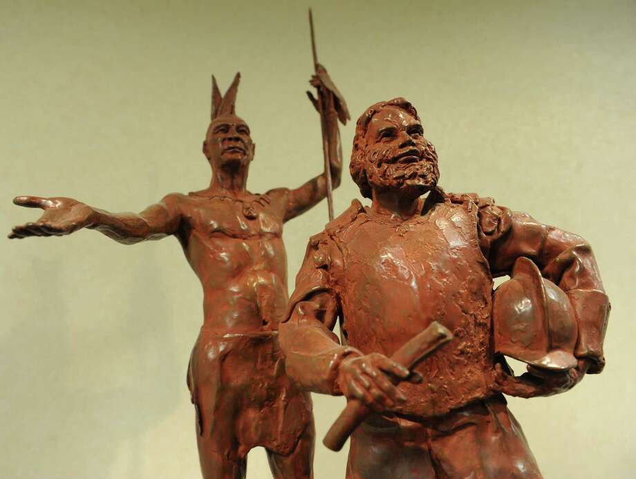 A bronze sculpture depicts Mayn Mayano, Chief of the Siwanoy tribe, and Captain Daniel Patrick of the Massachusetts Militia, transferring the deed for the patch of land that became Greenwich on the second floor of Town Hall in Greenwich, Conn. Thursday, Feb. 19, 2015.  Captain Patrick and Robert Feake paid 25 English-colored coats for the the piece of land between Asamuck Brook and Potamuck Brook stretching inland in a northerly direction for an indefinite distance. Photo: Tyler Sizemore / Greenwich Time