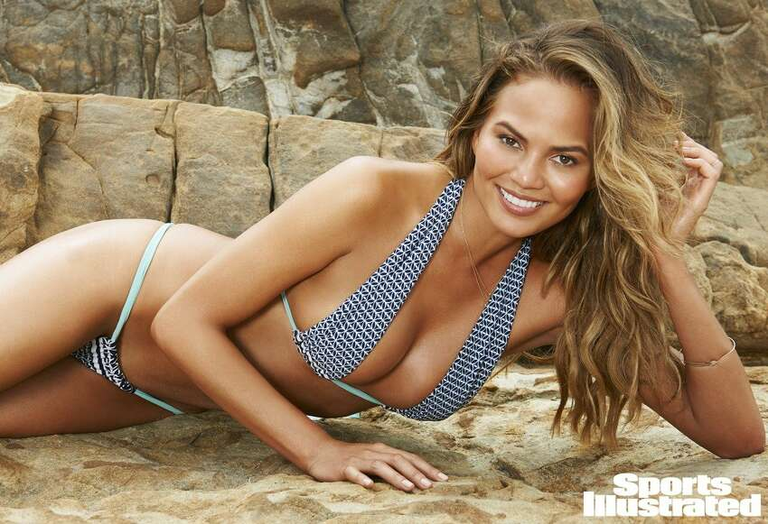 Model Chrissy Teigen, the 29-year-old wife of singer John Legend, was photographed for Sports Illustrated on the beach in California.