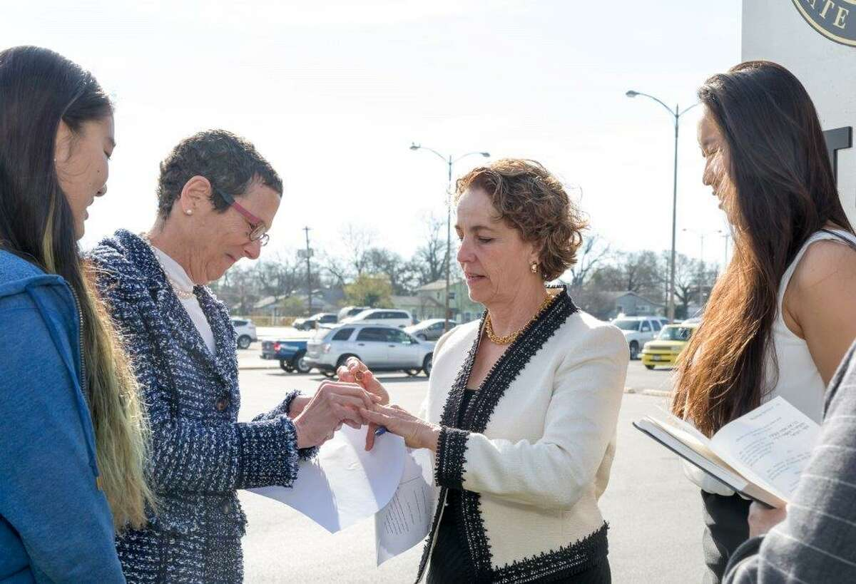 Sarah Goodfriend (second from left) marries Suzanne Bryant outside of the Travis County Clerk's Office in Austin on Thursday, January 19, 2015. They are flanked by their daughters Ting, 13, and Dawn, 18.