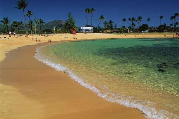 Clear waters of Poipu Beach Park on Kauai's south shore.