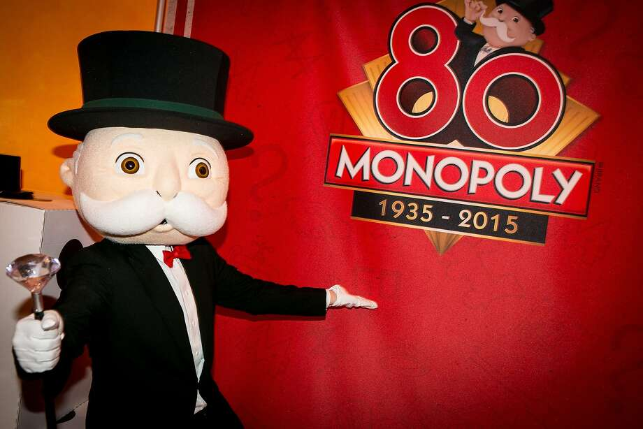 IMAGE DISTRIBUTED FOR HASBRO - Mr. Monopoly in the Hasbro showroom on Monday, Feb 16, 2015, to celebrate the Monopoly brand's 80th anniversary during the North American International Toy Fair in New York. Since its debut in 1935, the Monopoly brand has captivated more than 1 billion players in 114 countries around the world with its top hats, tokens, Chance Cards, and the thrill of passing GO! In 2015, Hasbro will celebrate the Monopoly brand's 80th anniversary by offering fans multiple ways to experience the world's favorite family gaming brand including new products, entertainment and events.  (Photo by Matt Peyton/Invision for Hasbro/AP Images) Photo: Matt Peyton, Associated Press