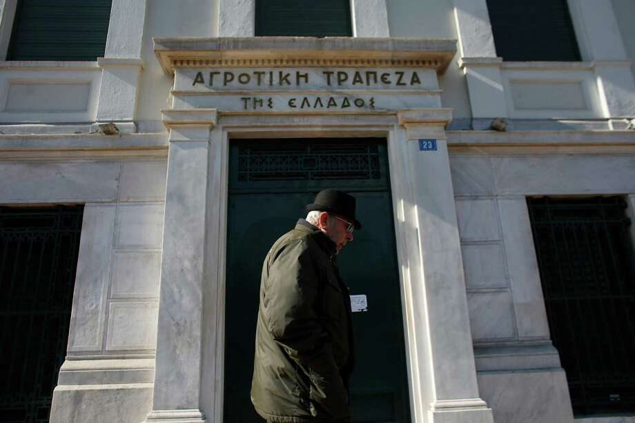 A pedestrian passes an Agricultural Bank of Greece bank branch in Athens, Greece, on Thursday, Feb. 19, 2015. Germany rebuffed Greece's request for an extension of its aid program, saying the Greek offer doesn't meet the euro region's conditions for continuing aid. Photographer: Kostas Tsironis/Bloomberg Photo: Kostas Tsironis / Bloomberg / © 2015 Bloomberg Finance LP