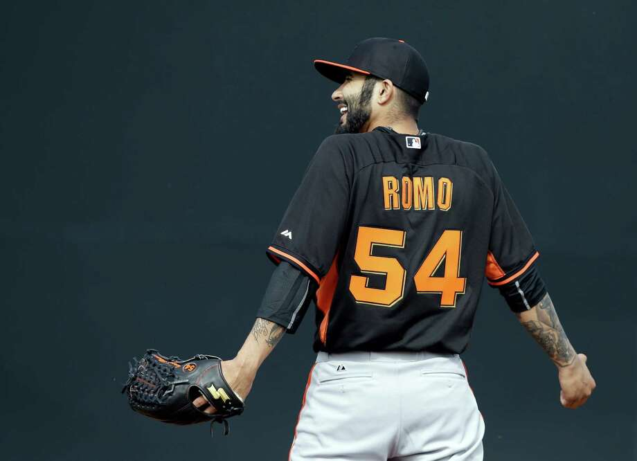 Giants setup man Sergio Romo, reacting after missing a ground ball during practice Thursday, reported soreness in his pitching shoulder. Photo: Darron Cummings / Associated Press / AP