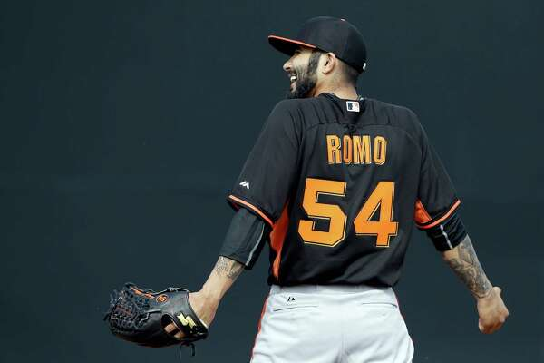 Giants setup man Sergio Romo, reacting after missing a ground ball during practice Thursday, reported soreness in his pitching shoulder.