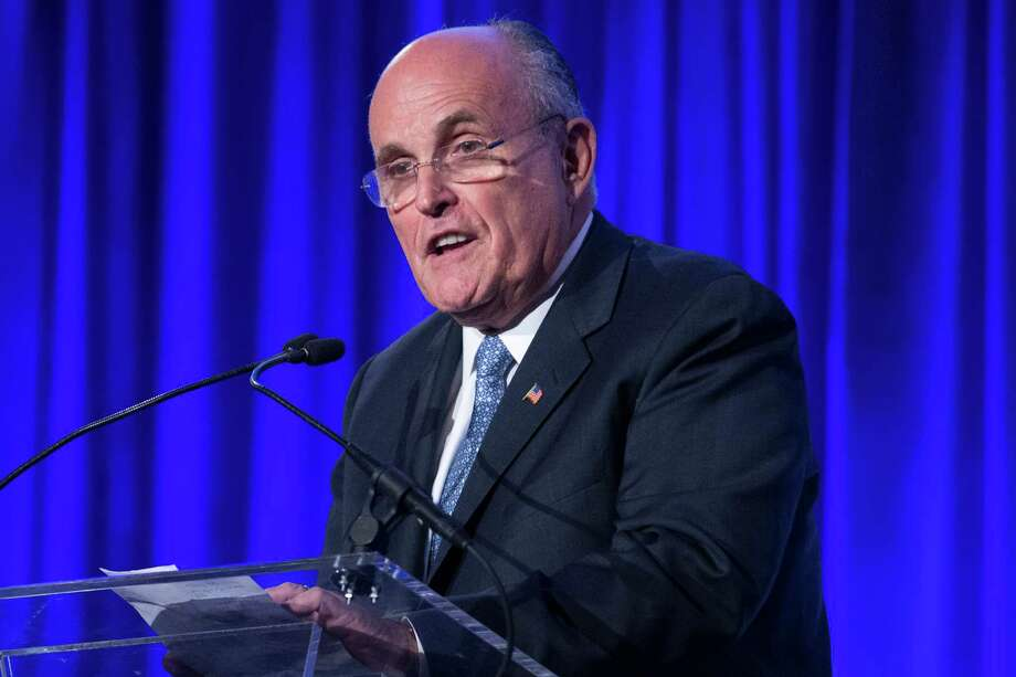 Former New York Mayor Rudy Giuliani questioned President Obama's love of country in a speech. Photo: John Minchillo / Associated Press / FR170537 AP