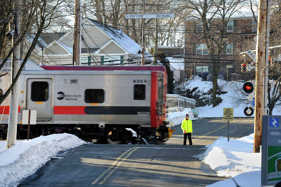 A Metro-North train crosses Riverbend Drive South in the Springdale neighborhood of Stamford, Conn., on Thursday, Feb. 5, 2015. Photo: Jason Rearick / Stamford Advocate