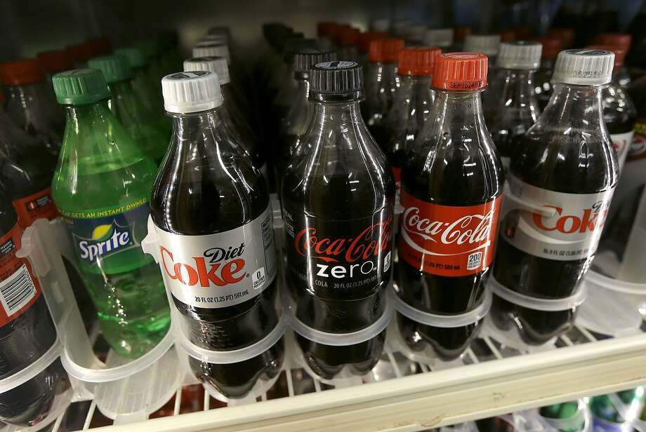A shelf of soft drinks are shown in a refrigerator at K & D Market in San Francisco, Wednesday, Oct. 1, 2014. A tax on sodas and other sugar-laden drinks that voters and courts in other parts of the country have rejected is on the November ballots in San Francisco and Berkeley, two cities that have been open to such social-engineering initiatives in the past. (AP Photo/Jeff Chiu) Photo: Jeff Chiu, Associated Press