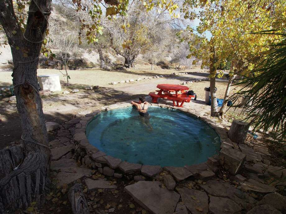 A round outdoor hot tub is among the soaking spots at the quiet and remote Chinati Hot Springs resort in West Texas. Photo: Chris LeBlanc, MBR / Tribune News Service