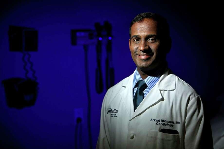 Dr. Arvind Bhimaraj, a cardiologist at Houston Methodist Hospital uses a new device that monitors heart patients. Photo: Gary Coronado, Staff / © 2015 Houston Chronicle