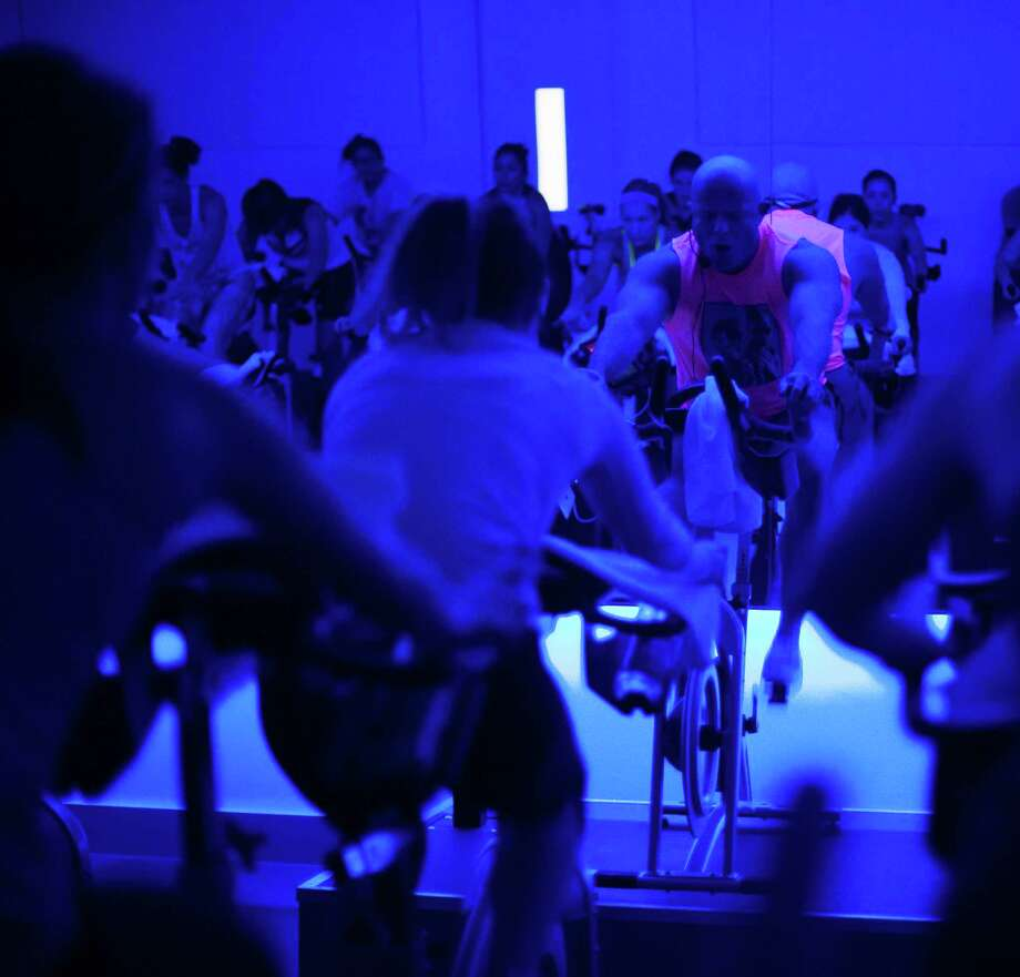 Will Longoria, an instructor at RIDE, leads a Rihanna and Justin Timberlake themed indoor cycling excercise class at RIDE Indoor Cylcing Studio in the Heights Photo: Michael Starghill, Jr., Photographer / © 2015 Michael Starghill, Jr.