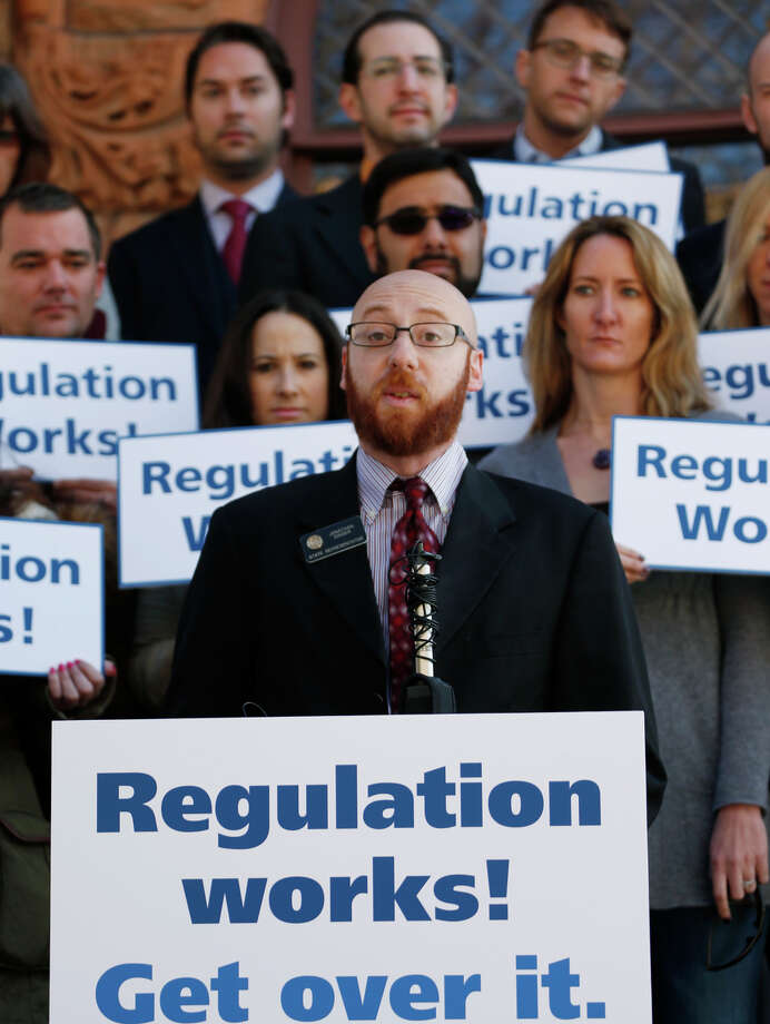 State Rep. Jonathan Singer speaks in Denver at a gathering of supporters of legal marijuana who oppose the lawsuits. Photo: David Zalubowski / Associated Press / AP