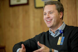 Wal-Mart CEO Doug McMillon's company is offer ing more pay and training than it has in the past.