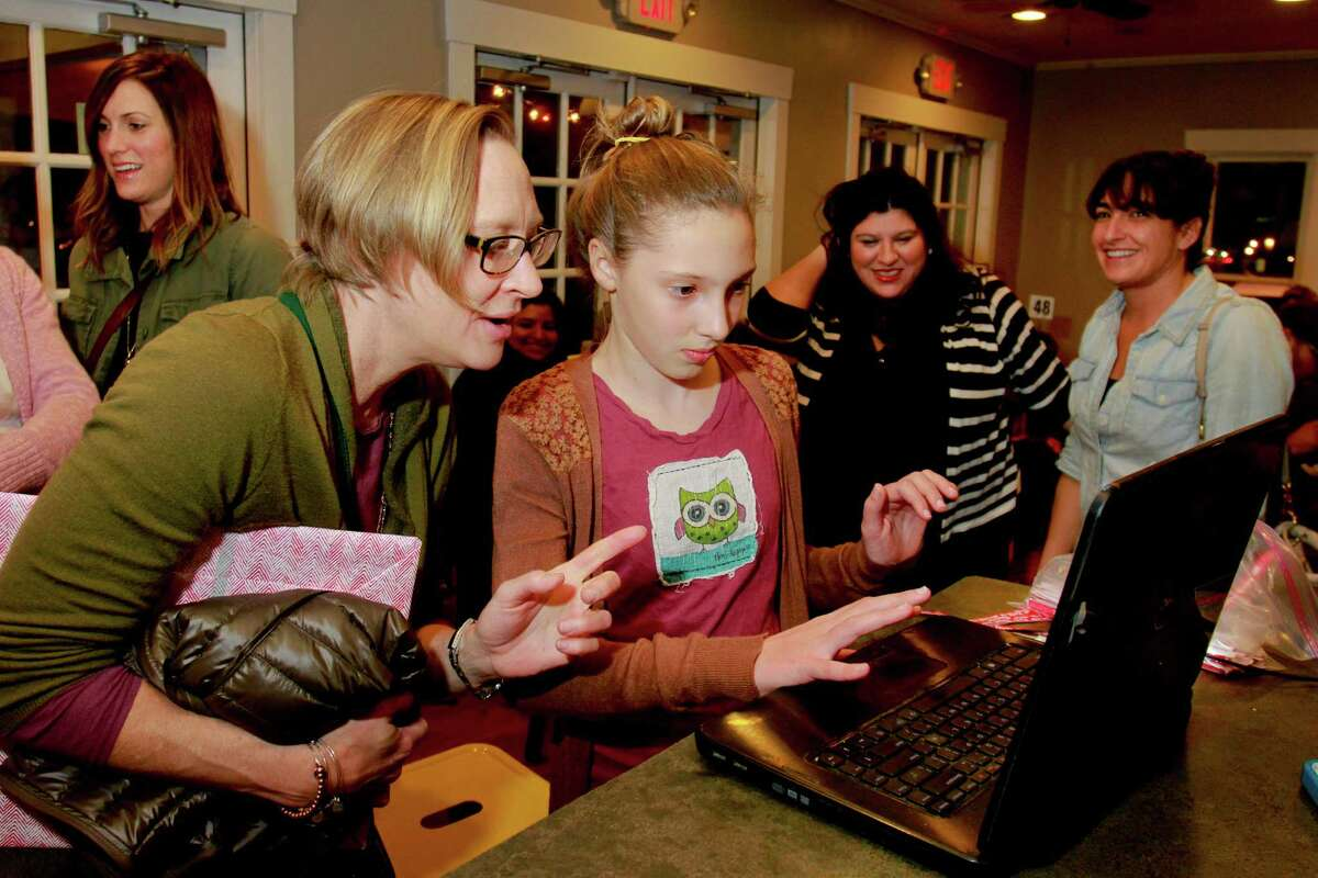 Pam Gilbert, and her daughter, Harper, 11, make a donation to Sean Carroll's kickstarter campaign. Sean Carroll and his wife Tish Ochoa, kicked off the campaign with a party at Good Dog Hot Dog on Studewood. Sean is the chef/owner of the wildly popular mobile kitchen known as Melange Creperie. Sean's initial goal to raise $50,000. But he says if the campaign can raise $100,000, then he would be able to reach his ultimate goal, keeping his business in Montrose. (For the Chronicle/Gary Fountain, February 4, 2015)