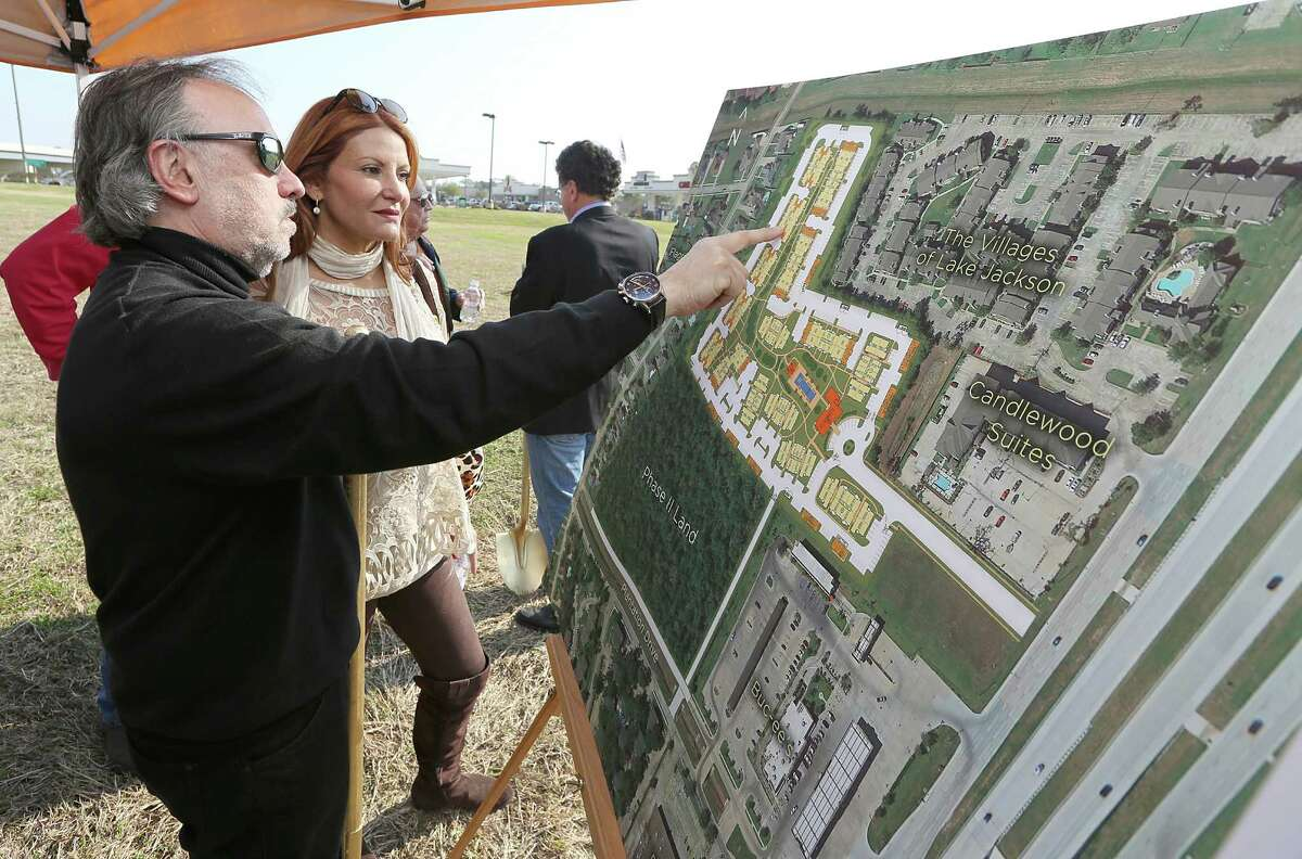 From left to right, Ralph and Mimi Howard look over the plans for a new apartment complex during a ground breaking on Thursday, February 12, 2015. Lake Jackson, the town of 26,000 an hour south of Houston, may be poised for a rebirth, spurred by billions in industrial construction by petrochemical industry in the Brazosport area.(Photo: Thomas B. Shea/For the Chronicle)
