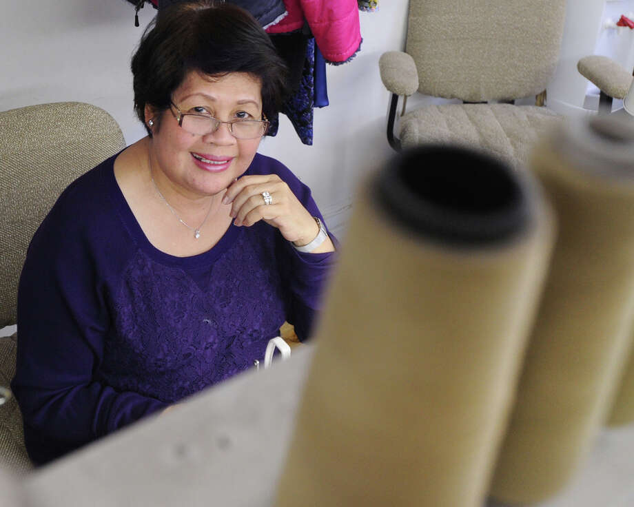 Norwalk resident, Evangeline Valenton, in the Best Ever Cleaners tailor shop located at 69 Greenwich Ave., Greenwich, Conn., Thursday, Feb. 12, 2015. Valenton, a native of the Philippines, who works as a seamstress for the cleaners, became an American citizen four years ago. Photo: Bob Luckey / Greenwich Time