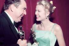 American actress Grace Kelly (1929 - 1982) and screenwriter George Seaton (1911 - 1979) celebrate their wins at the Academy Awards in Los Angeles, 30th March 1955. They both received Oscars for the 1954 film 'The Country Girl'. (Photo by Silver Screen Collection/Hulton Archive/Getty Images)