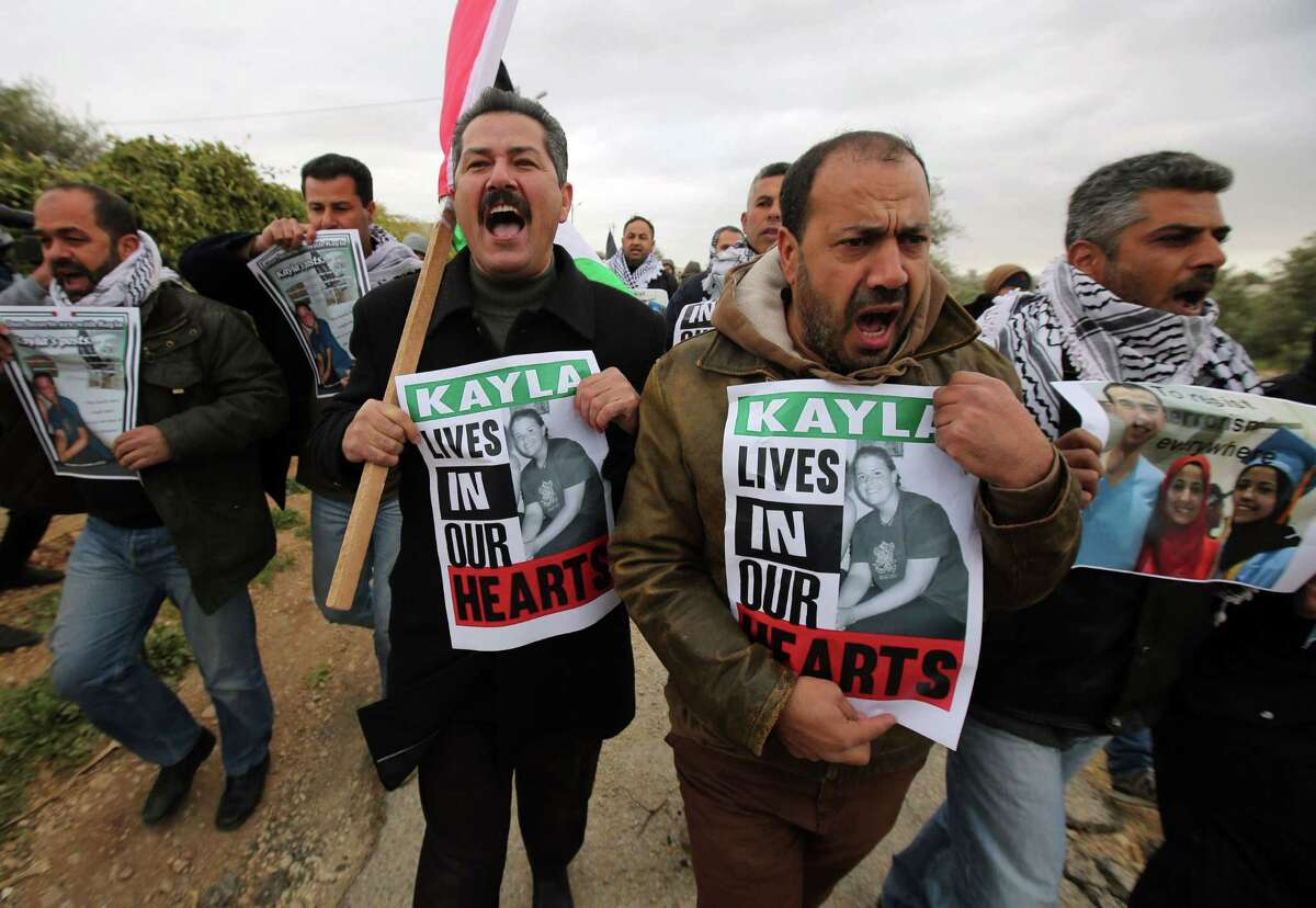 Palestinian protesters hold placards with the image of Kayla Mueller, the American recently killed by jihadists, during a demonstration in the West Bank village of Bilin, west of Ramallah. A reader expresses grief over the murder of the U.S. hostage, while another reader laments the sorrow inflicted on innocent people throughout the world.