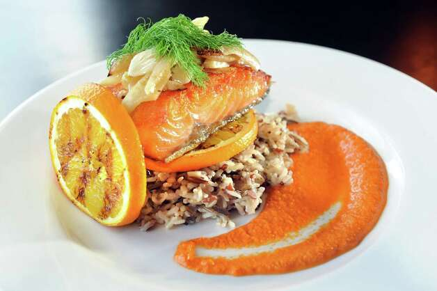 Pan Seared Salmon on Thursday, Feb. 12, 2015, at Roux restaurant in Slingerlands, N.Y. (Cindy Schultz / Times Union) Photo: Cindy Schultz / 00030560A