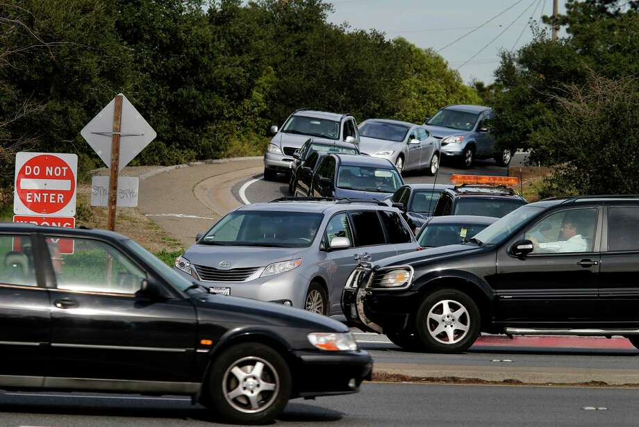 The merge onto northbound El Camino Real from highway 92 has to wait until traffic clears Thursday February 12, 2015. Several Bay Area freeway onramps are notoriously difficult and dangerous to navigate. . Photo: Brant Ward / The Chronicle / ONLINE_YES
