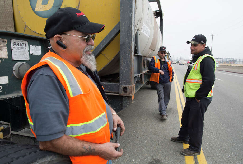 Stockton truckers Jose Gutierrez (left), Jose Lopez and Fran cisco Sanchez wait to drop off their loads at Oakland's port. Photo: Tim Hussin / Special To The Chronicle / ONLINE_YES