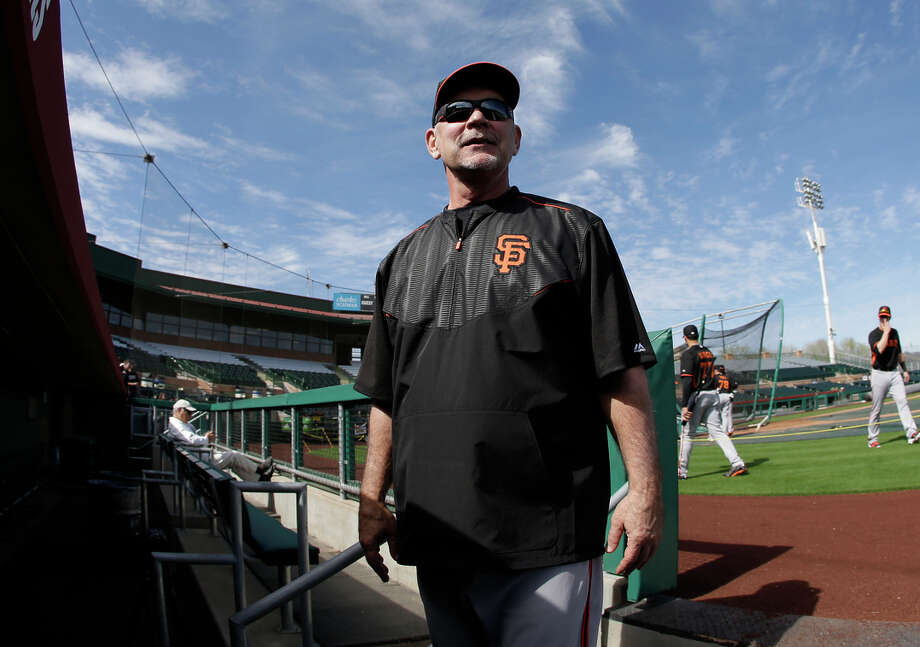 Giants manager Bruce Bochy talks with fans as he leaves the field following a spring training baseball practice Thursday, Feb. 19, 2015, in Scottsdale, Ariz. (AP Photo/Darron Cummings) Photo: Darron Cummings / Associated Press / AP