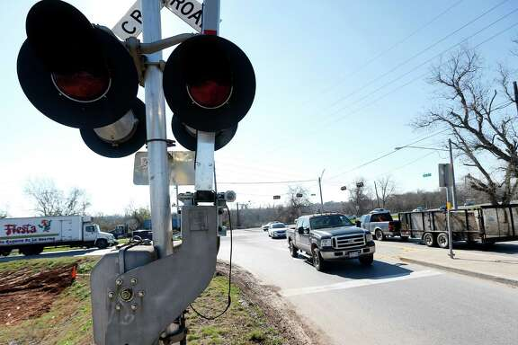 Drivers cross over the railroad tracks at the intersection of FM 359 and U.S. 90A, Monday, Feb. 9, 2015, in Richmond, where TxDOT is planning an elevated intersection over the train tracks.