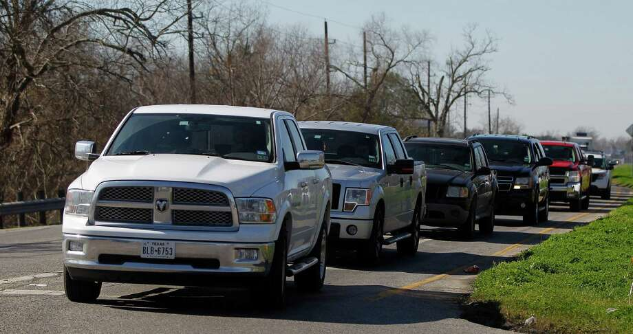 Drivers line up to make a left turn from eastboundU.S. 90Aat the intersection of FM 359 on Feb. 9 near Richmond, where TxDOT is planning an elevated intersection over the train tracks. Photo: Karen Warren, Houston Chronicle / © 2015 Houston Chronicle