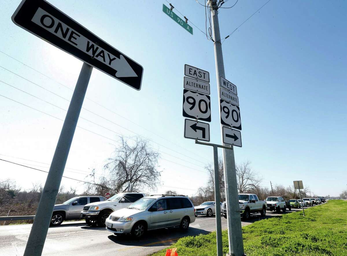 Drivers line up to make a left turn from U.S. 90A east bound at the intersection of FM 359 and U.S. 90A, Monday, Feb. 9, 2015, in Richmond, where TxDOT is planning an elevated intersection over the train tracks.