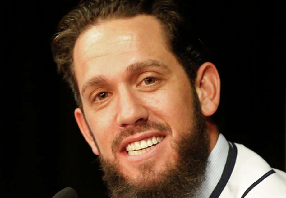 James Shields sports a big smile as he talks about joining thew San Diego Padres  after signing a four year contract with the team Wednesday, Feb. 11, 2015, in San Diego. General manager A.J. Preller, left,  listens. (AP Photo/Lenny Ignelzi) Photo: Lenny Ignelzi / Associated Press / AP