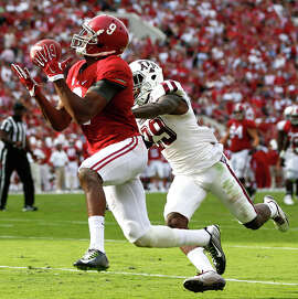 Alabama's Amari Cooper (left) had his way with the SEC, and could be a game-breaker for Oakland.