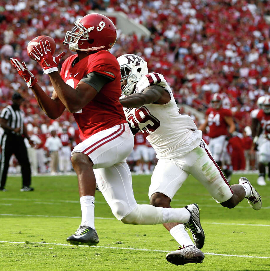 Alabama's Amari Cooper (left) had his way with the SEC, and could be a game-breaker for Oakland. Photo: Kevin C. Cox / Getty Images / 2014 Getty Images