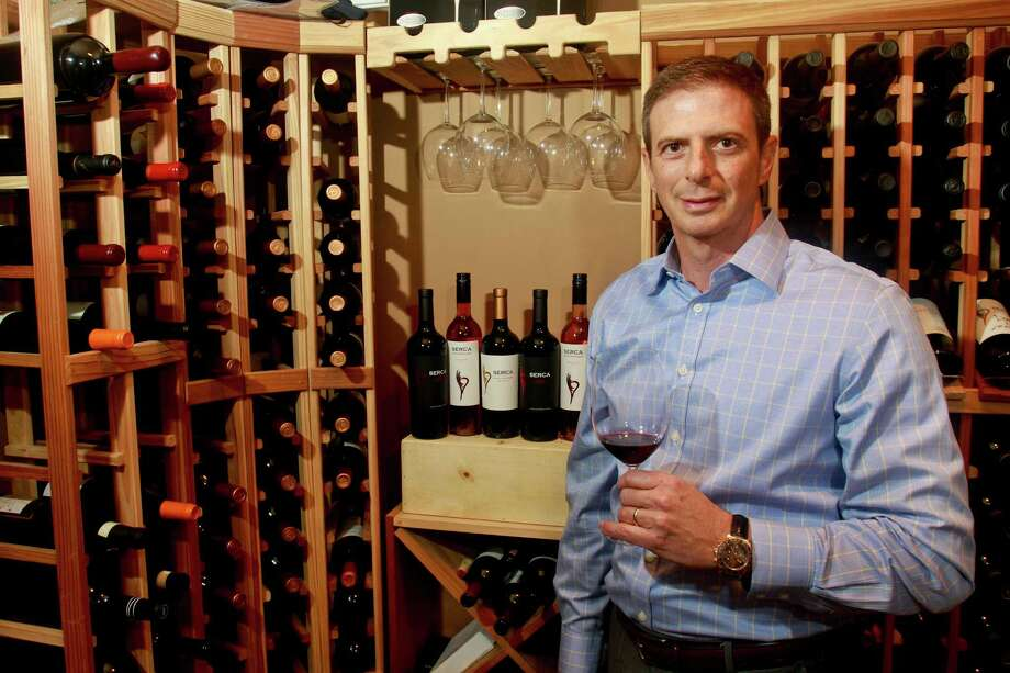 Sergio Weitzman of SERCA Wines enjoys a glass of his 2012 Malbec Gran Reserva in his private wine cellar in Houston.  Photo: Gary Fountain, Freelance / Copyright 2015 by Gary Fountain