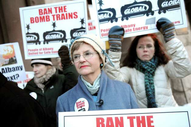 Sandy Steubing, spokesperson for People of Albany United for Safe Energy, center, calls for the Common Council to support an oil train ban on Thursday, Feb. 19, 2015, at City Hall in Albany, N.Y. (Cindy Schultz / Times Union)