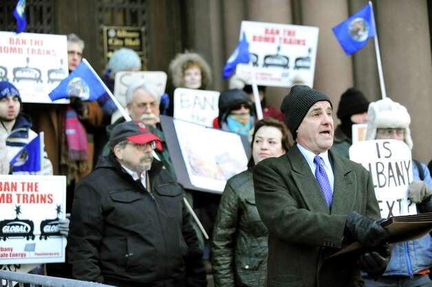 Chris Amato, attorney for Earth Justice, second from right, calls for the Common Council to support an oil train ban on Thursday, Feb. 19, 2015, at City Hall in Albany, N.Y. (Cindy Schultz / Times Union) Photo: Cindy Schultz / 00030683A