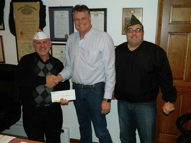 Rensselaer County Legislator Rob Bayly presented funding to support community programs sponsored by the Sullivan-Jones Veterans of Foreign Wars Post 7466 in Poestenkill to Commander John Willsey, left, and Senior Vice Commander Lee Vartigian, right. The funding was also presented on behalf of Legislators Leon Fiacco, Phil Danaher and Kelly Hoffman. (Rich Christ)
