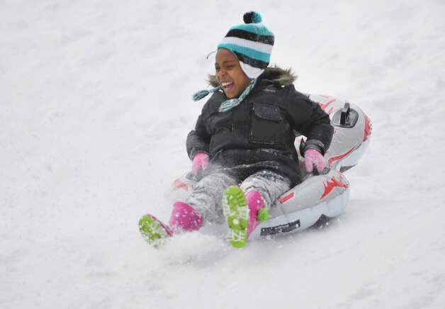 Athena Hooper, 6, slides down a hill at Central Park on Thursday, Feb. 19, 2015, in Schenectady, N.Y.    (Paul Buckowski / Times Union) Photo: STAFF / 00030689A