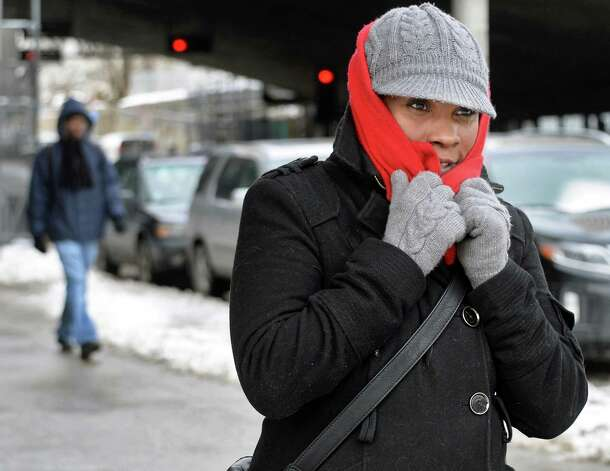 Veronica Horne of Ravena bundles up against a cold wind as she makes her way down Madison Avenue past the State Museum Thursday, Feb. 19, 2015, in Albany, N.Y.  (John Carl D'Annibale / Times Union) Photo: John Carl D'Annibale / 00030689A