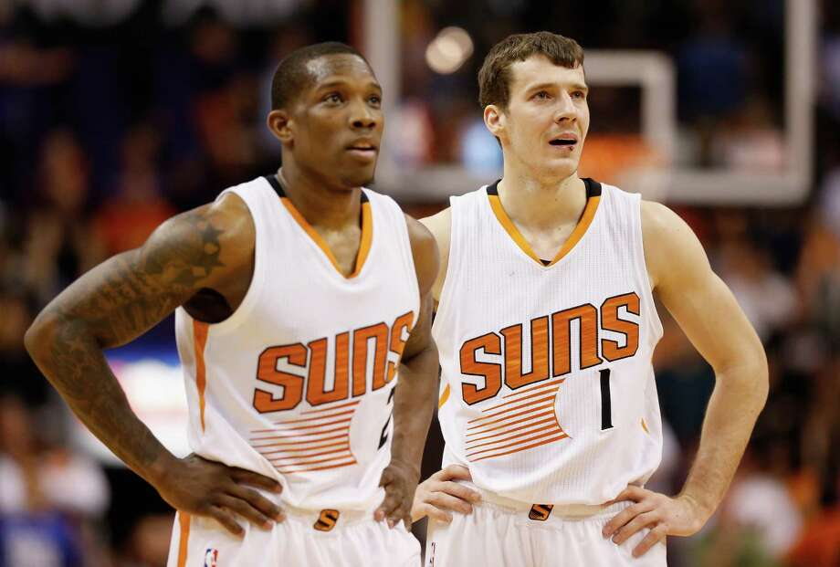 PHOENIX, AZ - JANUARY 21:  (R-L) Goran Dragic #1, and Eric Bledsoe #2 of the Phoenix Suns look on during a break from the NBA game against the Portland Trail Blazers at US Airways Center on January 21, 2015 in Phoenix, Arizona. The Suns defeated the Trail Blazers 118-113. NOTE TO USER: User expressly acknowledges and agrees that, by downloading and or using this photograph, User is consenting to the terms and conditions of the Getty Images License Agreement.  (Photo by Christian Petersen/Getty Images) Photo: Christian Petersen, Staff / 2015 Getty Images