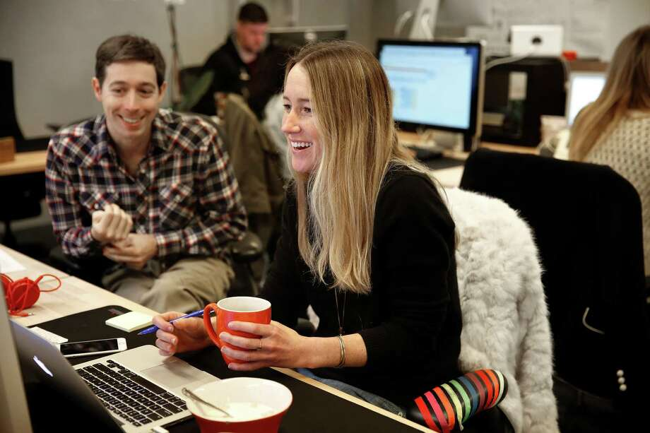 Co-founder CEO David Bladow (left) works with brand manager Sarah Wattson (right) at BloomThat in San Francisco, Calif., on Monday, February 9, 2015. Photo: Liz Hafalia / The Chronicle / ONLINE_YES